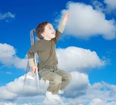 Child on ladder touching the clouds